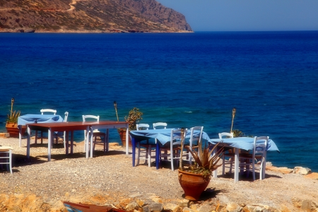 traditional greek outdoor restaurant with Mediterranean sea view(Crete, Greece). photo