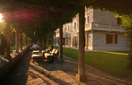 Sun beams and beautiful italian mansion with outdoor cafe on summer terrace (Italy) photo