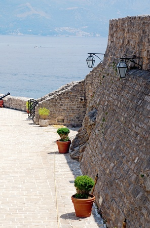 Mediterranean sea view with old stone italian terrace. Vertical image. photo
