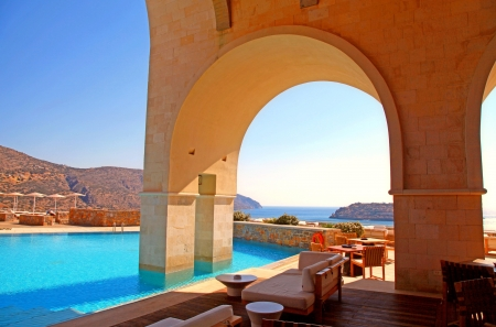 hotel balcony:  arch pool terrace on summer luxury resort  Greece  with beautiful Mediterranean sea view  Editorial