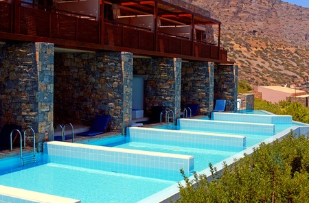 Summer resort with row of private swimming pools Greece  Stock Photo - 16206214