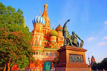 View of St Basils Cathedral, the famous and iconic cathedral on Red Square in Moscow ( Russia) with The Minin and Pojarsky monument. photo