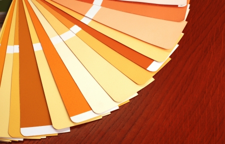 ral: open RAL pantone sample colors catalogue on wood background, horizontal image