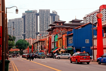 singapore city: SINGAPORE, SINGAPORE - DECEMBER 28: Colorful chinese shops in a street of Chinatown district and business skyscrapers on background in Singapore on December 28, 2010. Singapores Chinatown is an ethnic neighbourhood featuring distinctly Chinese cultural e