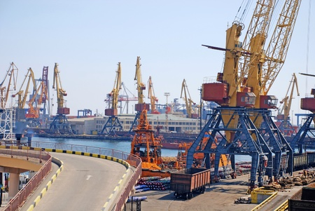haulage: A cargo container ships and cranes is docked at the shipyard.