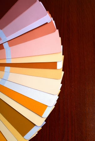 ral: open RAL pantone sample colors catalogue on wood background, vertical image