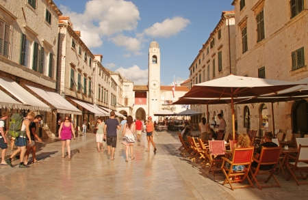 Dubrovnik, Croatia - July 20, 2011 : Tourists walking on the main street Stradun in the old town of Dubrovnik, Croatia. Many of the historic buildings and monuments in Dubrovnik are situated along the Stradun, because of which it serves as a popular espla