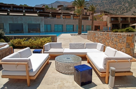 outdoor furniture on beautiful mediterranean patio in summer resort(Greece), wide angle Éditoriale