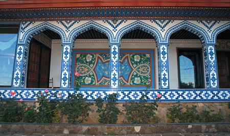Arabic house with decorative arches and walls covered ornamental tiles photo