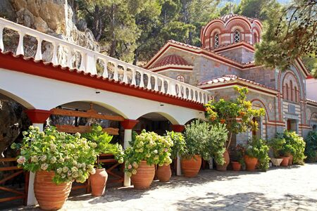 Beautiful garden with patio and flower pots in old mountain orthodox monastery(Crete, Greece) photo