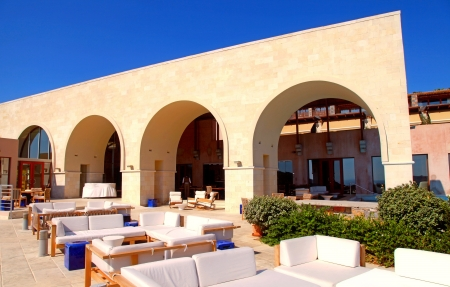 arch terrace with outdoor lounge furniture on summer luxury resort  (Greece)