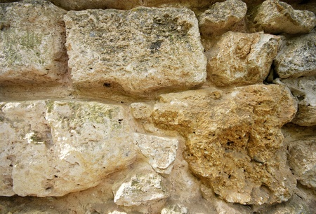 Old stone rough mediterranean wall as background. Stock Photo - 18224948