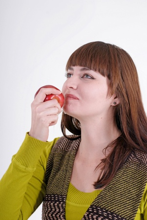 Portrait of  beautiful young woman eating juicy apple. Copy space for your text photo