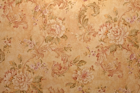 Vintage golden run-down victorian wallpaper with baroque floral pattern