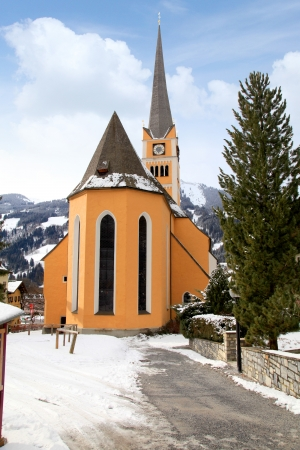 Church tower in the village Bad Hofgastein near Salzburg, Austria  Alps, winter photo