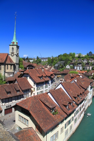 Vintage brown tiled rooftops of old houses in Bern - capital of Switzerland  Vertical view photo