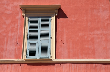 typical old french shutter window in red house of Nice, Cote d photo