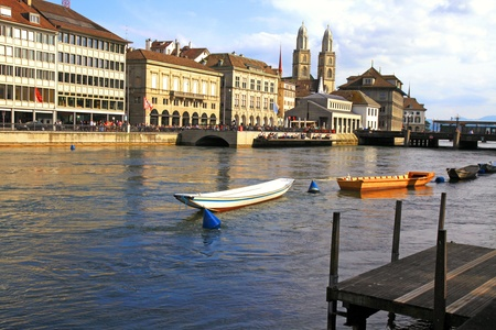 grossmunster cathedral: Zurich cityscape with  Grossmunster cathedral, boats and river Limmat, Switzerland