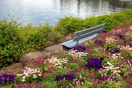 Beautiful landscape with wooden bench and flowers at alpen lake in Montreux  Switzerland  photo