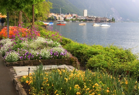 A beautiful spring landscape with flowers, Lake Geneva and view of Montreux, Switzerland  photo