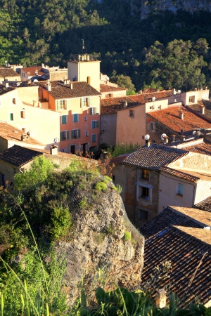 roussillon: Small medieval village with old beautiful traditional houses on the hills in Provence, France  Sunset light, vertical image
