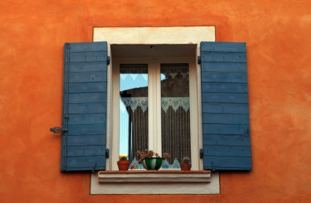 old french open window with blue shutters in red rural house, Provence, France   photo