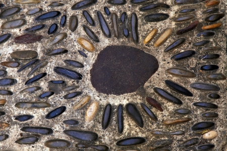 Cobblestone pavement background with natural pebbles photo