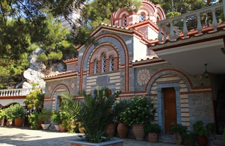 Beautiful garden patio and flower pots in old mountain orthodox monastery(Crete, Greece) photo