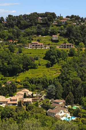 Beautiful view of green hill and mansions in the village Saint-Paul-de-Vence , Provence, South France. Vertical image  photo