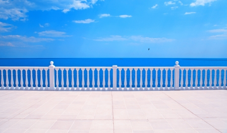 Summer view with classic white balustrade and empty terrace overlooking the sea  Italy  photo