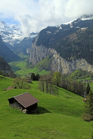 Beautiful traditional mountain village in the Alps, Switzerland   Vertical image  photo