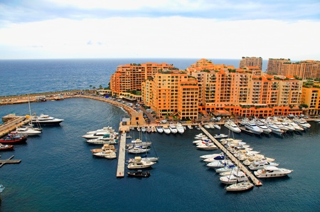 Panoramic landscape with harbor,pier and lots of yachts in famous Monte Carlo, Cote dAzur photo