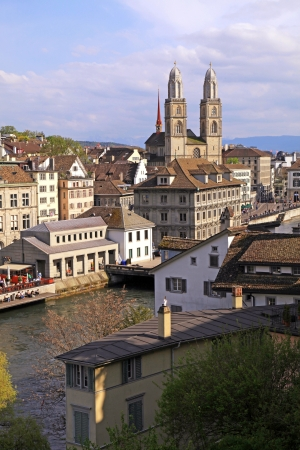 grossmunster cathedral: Zurich cityscape with old buildings, Limmat river and the Grossmunster cathedral , Switzerland  Vertical image
