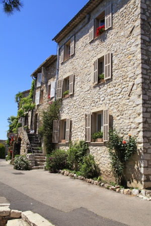 Street with beautiful rural sandstone houses in Saint-Paul de Vence, Provence, France photo