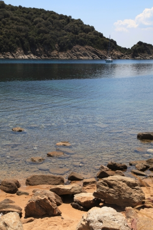 Mediterranean landscape with rocky beach and beautiful turquoise bay, Ammouliani island, Halkidiki, Greece. Vertical image photo