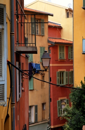 Multicolored houses with green shutters in the old town of Nice, French Riviera (Cote d'Azure), France.  photo