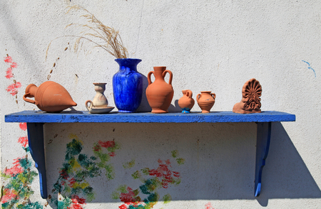 Traditional greek blue and terracota ceramic vase, Greece photo