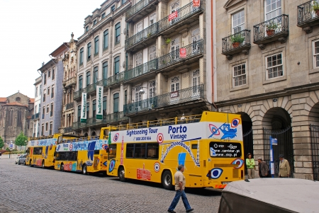 open topped: PORTO, PORTUGAL - MAY 5   City Sightseeing Tour bus at May 05, 2013 on the streets of Old Town in Porto, Portugal