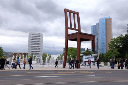 landmine: GENEVA, SWITZERLAND - MAY, 10: The Place of Nations(Place Des Nations), fountains and gigantic Broken Chair, symbol of the fight against landmines at May 10,2013  in Geneva, Switzerland.  Around are the headquarters of about 250 international organizati Editorial