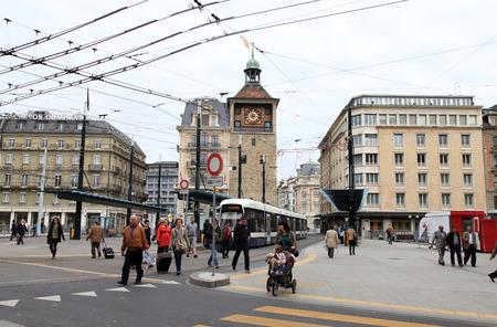 bel air: GENEVA, SWITZERLAND - MAY 11: People walking on Place de Bel-Air near LIle Clock Tower in Geneva, Switzerland at May 11, 2013.  Bel-Air tram stop is one of the major public transportation nodes of Geneva. Editorial