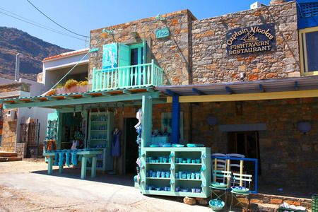 PLAKA, GREECE - JULY 14  Beautiful local souvenir shop where tourists can buy turquoise greek gifts at  July 14,2012 in greek village Plaka, Crete, Greece