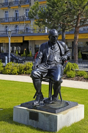 lolita: MONTREUX, SWITZERLAND - MAY 9: Bronze Statue of Vladimir Nabokov a Russian-American novelist, author of famous Lolita (1899 - 1977), stands in the gardens of the Montreux Palace in Montreux, Switzerland on May 9, 2013. On 1961 Nabokov and his wife moved t