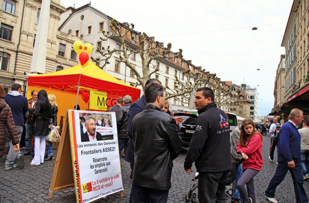 debate win: GENEVA, SWITZERLAND - MAY 11: People talk about politic near MCG campaign tent of  May 11, 2013 in Geneva, Switzerland. The Geneva Citizens Movement (French: Mouvement citoyens genevois), abbreviated to MCG, is a populist political party in the Canton of Editorial