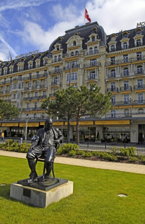 novelist: MONTREUX, SWITZERLAND - MAY 9: Bronze Statue of Vladimir Nabokov a Russian-American novelist, author of famous Lolita (1899 - 1977), stands in the gardens of the Montreux Palace in Montreux, Switzerland on May 9, 2013. On 1961 Nabokov and his wife moved t