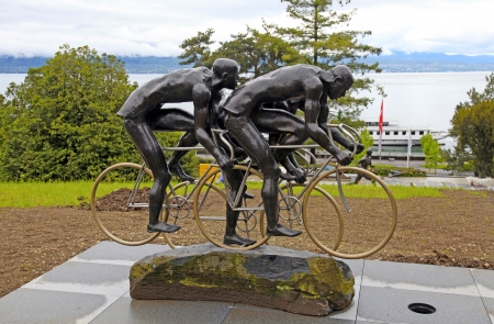 olympic symbol: LAUSANNE, SWITZERLAND - MAY 10: Cyclistes, sculpture by Gabor Mihaly, at Olympic museum in Lausanne, Switzerland on Lake Geneva at May 10, 2013. Olympic museum is the largest archive of Olympic Games in the world and one of Lausannes prime tourist site d