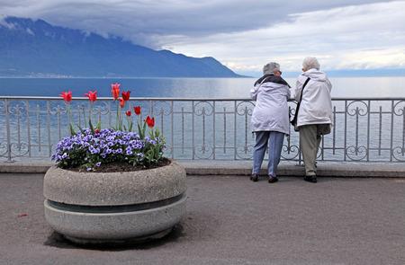 MONTREUX, SWITZERLAND - MAY 9: Senior women relaxing at lake Geneva waterfront in Montreux, Switzerland at May 9,2013.