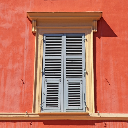 typical old grey french shutter window in red house of Nice, Cote d'azur, France. Square shape image  photo