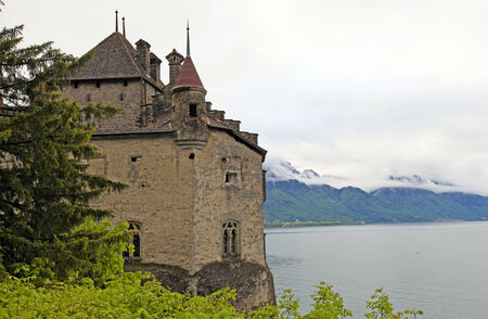The Chillon Castle (Chateau de Chillon) and lake Geneva, Montreux, Switzerland.