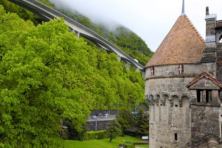 chillon: View of The Chillon Castle (Chateau de Chillon) and green Alps near Montreux, Switzerland