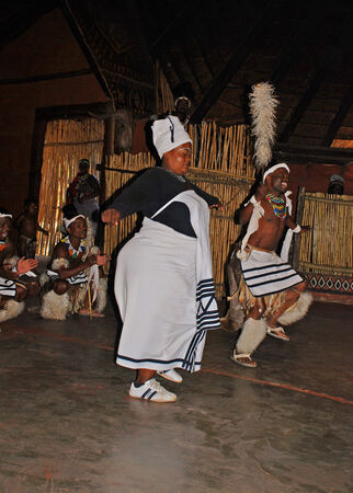 LESEDI VILLAGE, SOUTH AFRICA - DECEMBER 01,2008: A men and female group of South African Zulu dancers in ritual costumes entertaining for tourists on December 01, 2008 at the Cultural Village Lesedi, South Africa.